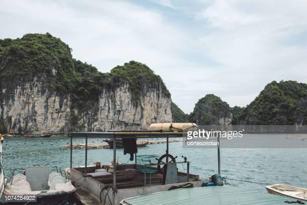 boat on sea against mountains - bortes stock-fotos und bilder