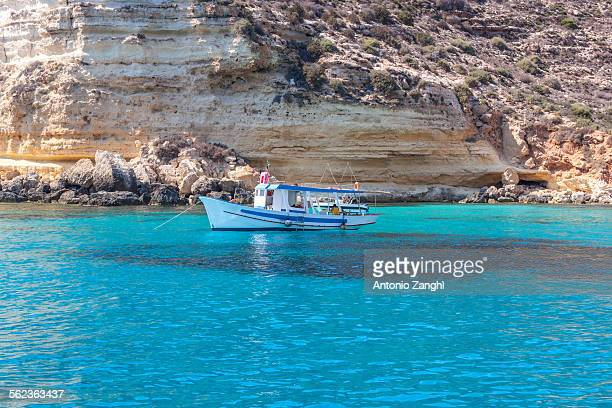 boat on sea of lampedusa - lampedusa stock pictures, royalty-free photos & images