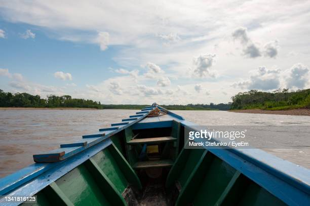 boat on tambopata river - marek stefunko stock pictures, royalty-free photos & images