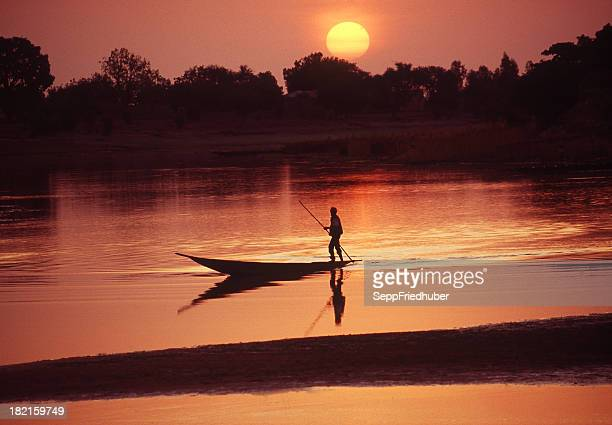 boat on the bani river in mali during sunrise - mali stock pictures, royalty-free photos & images