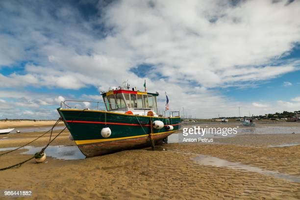 Boat on the beach at low tide. Cap Ferret (Arcachon Bay, France)