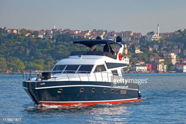 boat on the bosphorus in istanbul - gwengoat stock pictures, royalty-free photos & images
