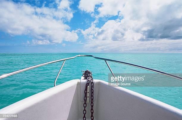 boat on the ocean - geländer stock-fotos und bilder