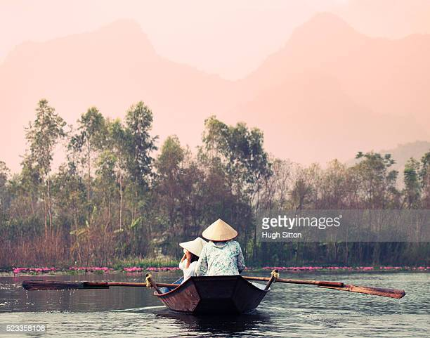 boat on the river near the perfume pagoda - hugh sitton stock-fotos und bilder