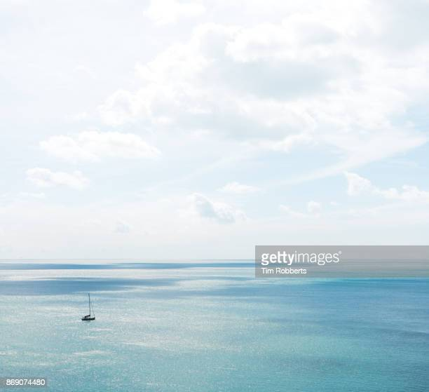 boat on the sea off the coast of devon - sailor stock pictures, royalty-free photos & images