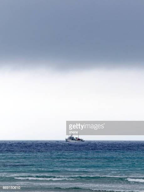 boat on the sea - parallel stock pictures, royalty-free photos & images