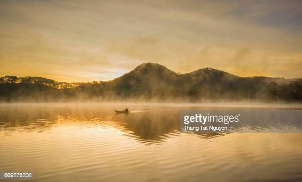 Boat on Tuyen Lam lake in morning fog in Dalat, Vietnam