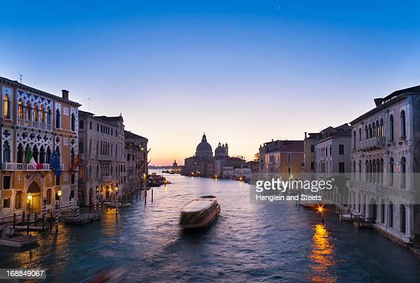 boat on venice canal - vaporetto stock-fotos und bilder
