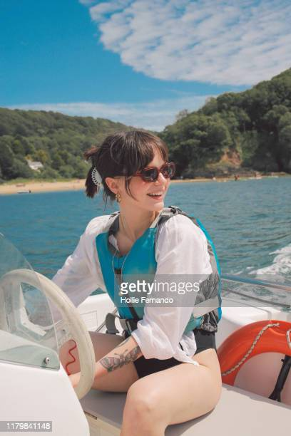 boat outing on british bay - coastline stock pictures, royalty-free photos & images