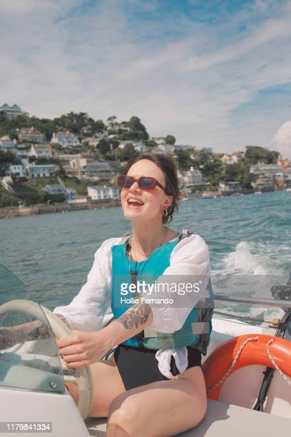 boat outing on british bay - tourism stock pictures, royalty-free photos & images