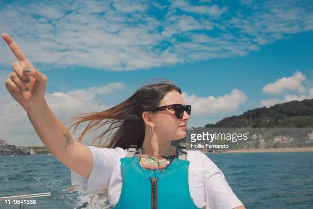 boat outing on british bay - beach stock pictures, royalty-free photos & images
