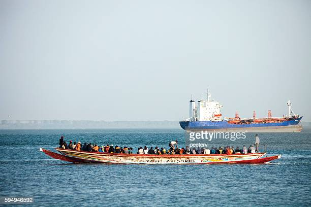 Boat overloaded with people. The Gambia.