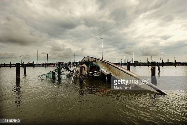A boat overturned by Hurricane Isaac floats in lower Plaquemines Parish on September 2 2012 in Buras Louisiana Today was the first day some residents...