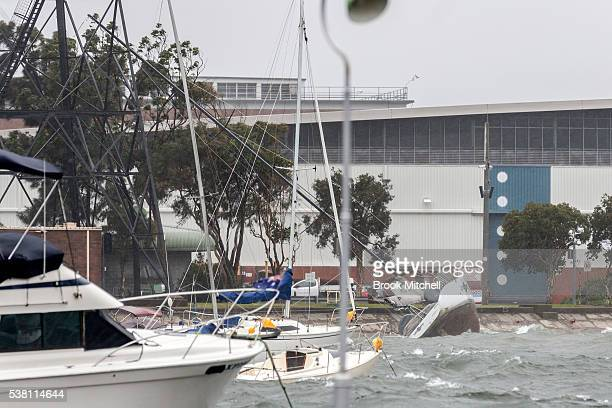 A boat overturned inside Sydney Harbour at Elizabeth Bay as an East Coast Low hits Sydney on June 5 2016 in Sydney Australia