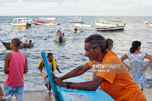 Boat owner fisherman waiting for more business February 2nd is the feast of Yemanja a Candomble Umbanda religious celebration where thousands of...