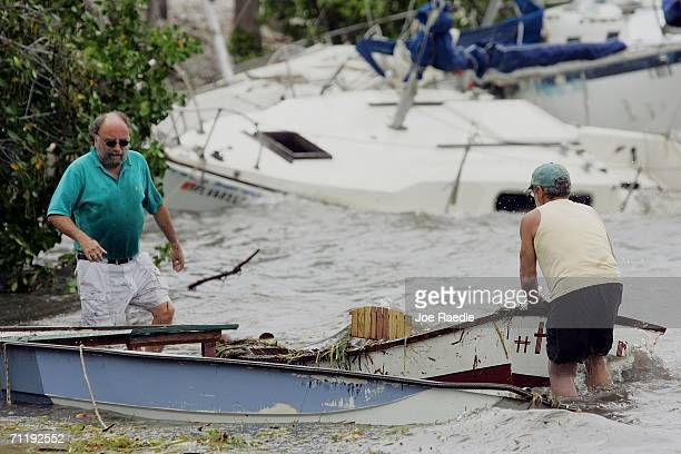 Boat owners try to refloat their small boats after they crashed ashore when Tropical Storm Alberto broke them from their moorings as it moved inland...