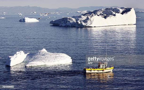A boat pases an ice fjord near Ilulissat in Greenland 17 August 2007 German Chancellor Angela Merkel and German Environment Minister Sigmar Gabriel...