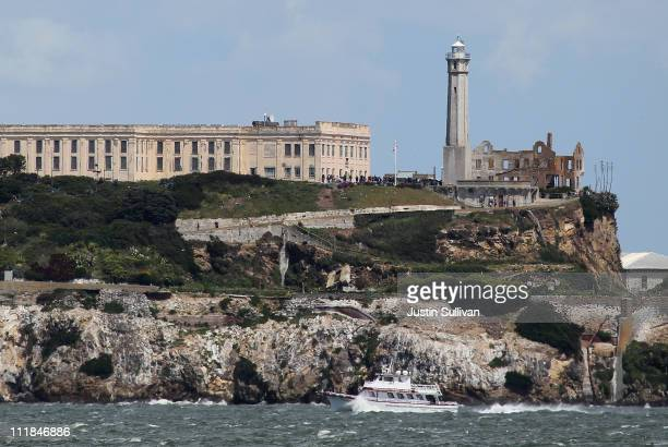 A boat passes Alcatraz Island on April 7 2011 in San Francisco United States If the federal budget impasse cannot be resolved by the Friday deadline...