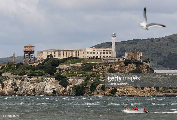 A boat passes in front of Alcatraz Island on April 7 2011 in San Francisco United States If the federal budget impasse cannot be resolved by the...