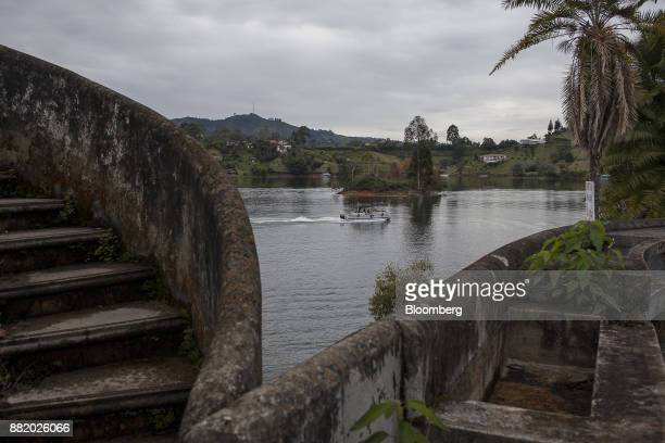 A boat passes in front of Narcotics kingpinPablo Escobar's lakeside villa ManuelaRanch in Medellin Colombia on Wednesday Oct 4 2017 Today the...