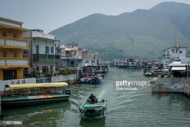 Boat passes stilt houses in the fishing village of Tai O on July 18, 2019 in Hong Kong, China. Hong Kong's earliest settlements were fishing villages...