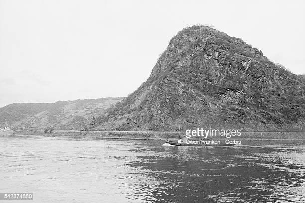 A boat passes the Lorelei rock along the Rhine | Location Near Bacharach West Germany