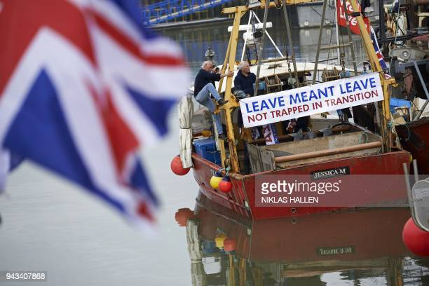 A boat prepares to depart during a demonstration in Whitstable southeast England on April 8 2018 against the Brexit transition deal that would see...