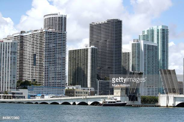 A boat prepares to pass under a draw bridge on the Miamai River as the city prepares for the approaching Hurricane Irma on September 7 2017 in Miami...