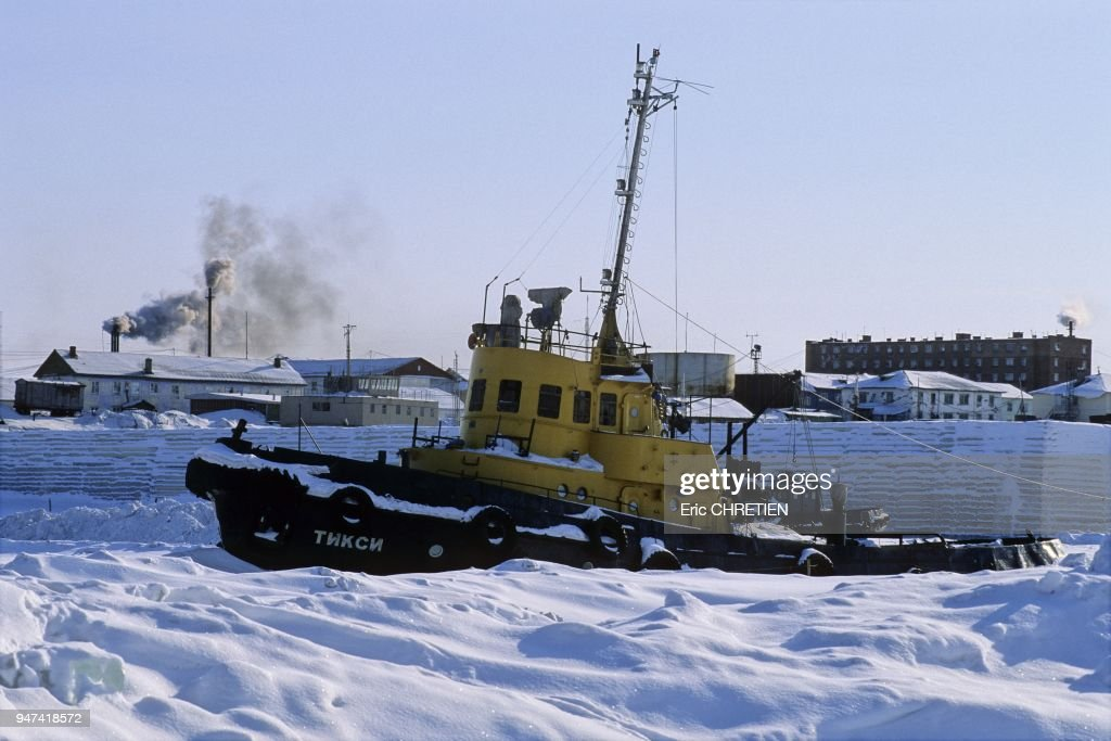 Boat prisoner of the ice field winter, harbour of Khatanga