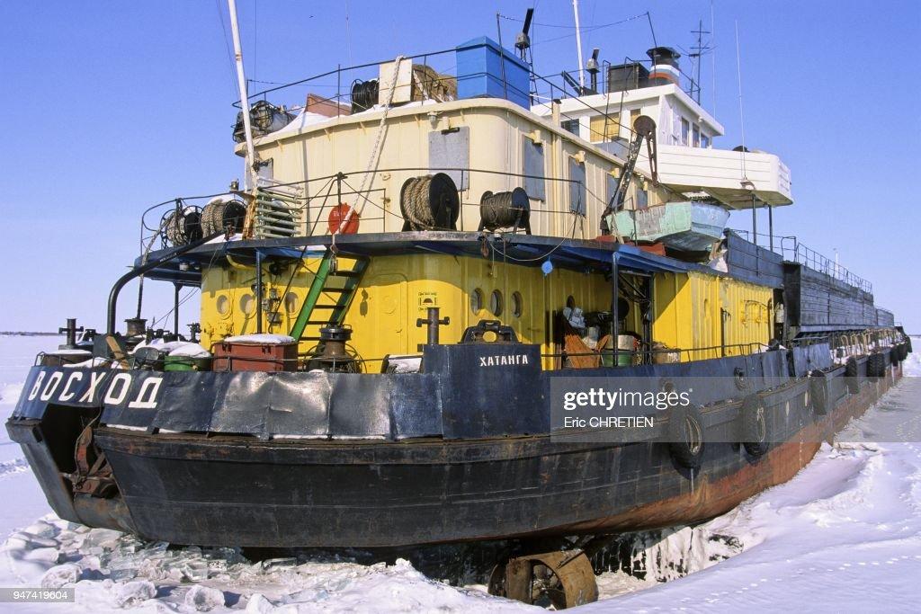 Boat prisoner of the ice field winter, Khatanga , Northern Siberia