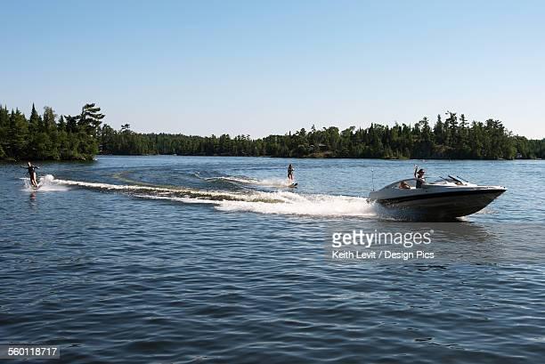 A boat pulling two waterskiiers