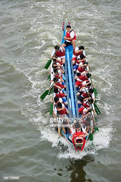 A boat racing on the Keelung River on the opening day of the annual Dragon Boat Festival a national holiday in Taiwan The dragon boat festival race...