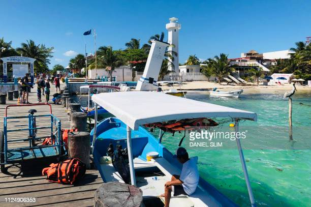 A boat remains docked by a pier in Puerto Morelos Quintana Roo state Mexico on February 14 2019