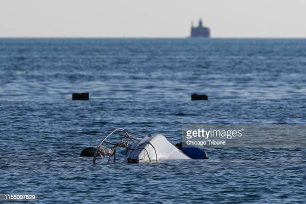 A boat remains upside down in the water south of West Fullerton Parkway at the lake front in Chicago on Thursday July 11 2019 A woman died and two...