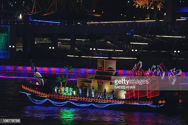 A boat representing a scene from Qatar motors up the Pearl River during the opening ceremony of the 16th Asian Games in Guangzhou on November 12 2010...