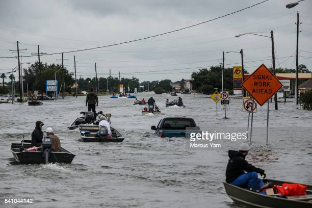 Boat rescue traffic on the flooded Jimmy Johnson Road in Port Arthur Texas on Aug 30 2017