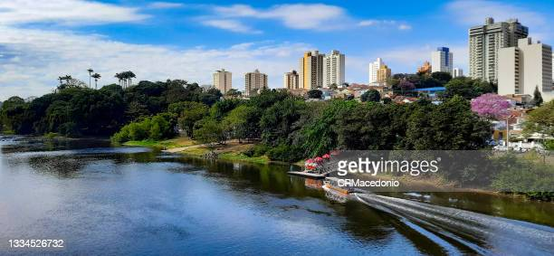 boat ride on the river on a beautiful sunday with blue sky. - crmacedonio stock pictures, royalty-free photos & images