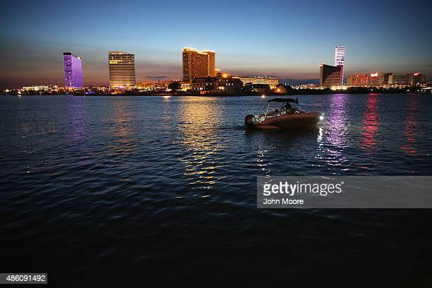 A boat rides past open casinos on August 28 2015 in Atlantic City New Jersey Some 8000 people were lost their jobs when four of Atlantic City's major...