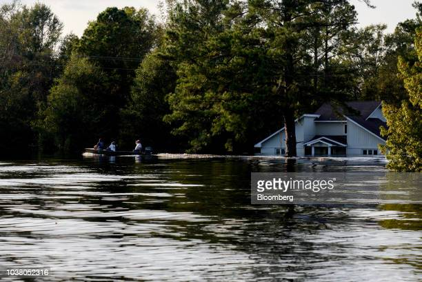 Boat rides through floodwater after Hurricane Florence hit in Bergaw, North Carolina, U.S., on Friday, Sept. 21, 2018. President Donald Trump lauded...