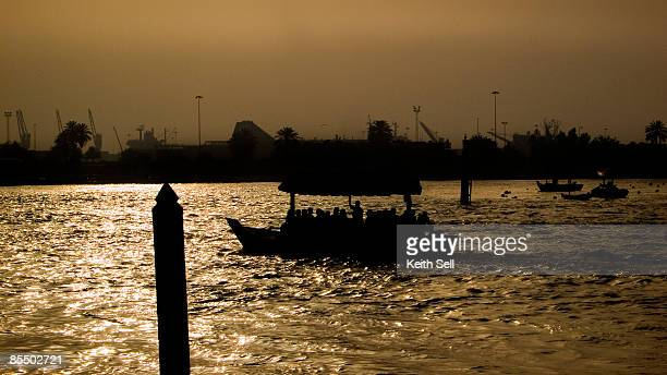 a boat sailing at the creek before sunset, dubai, uae. - expatriate stock pictures, royalty-free photos & images