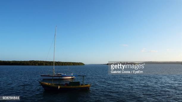 Boat Sailing In Sea Against Clear Sky
