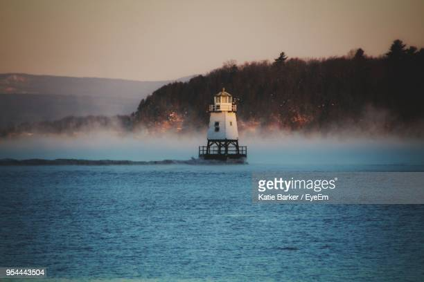 boat sailing in sea against clear sky - burlington vermont stock photos and pictures