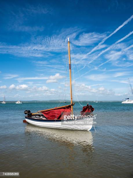 boat sailing in sea against sky - portsmouth england stock pictures, royalty-free photos & images