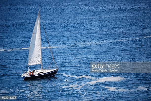 boat sailing in sea - maria tejada stock pictures, royalty-free photos & images