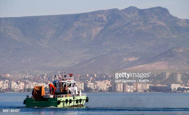 boat sailing in sea - igor golovniov stock pictures, royalty-free photos & images