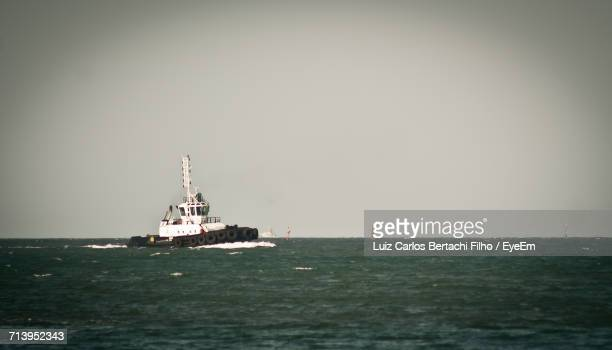boat sailing in sea - filho stock pictures, royalty-free photos & images