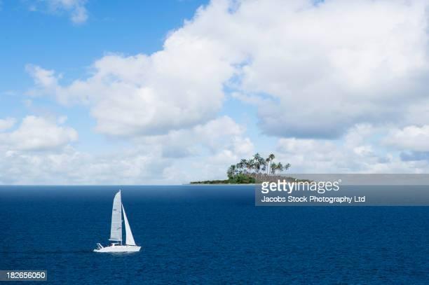 Boat sailing in tranquil ocean, Tahiti, French Polynesia