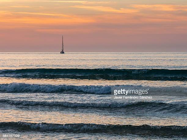 A boat sailing into the sunset