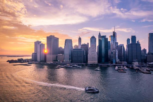 Boat sailing on east river past Lower Manhattan, Manhattan, New York, USA