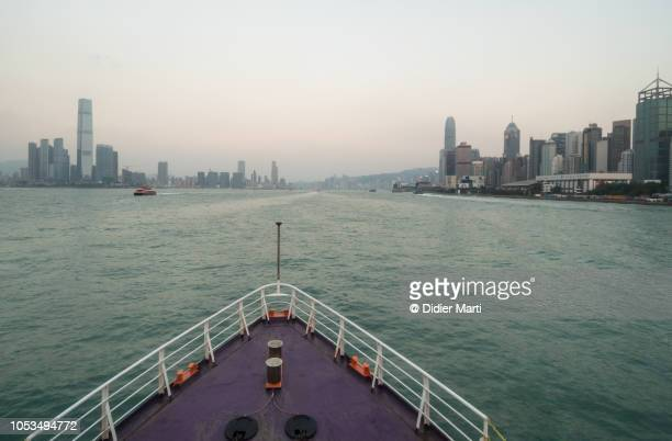 Boat sailing on Victoria harbour in Hong Kong, China